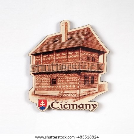 "Magnetic souvenir from Slovakia with the image of a black wooden house in the village of Tchitchmany. The inscription on the magnet Slovak village name means ""Tchitchmany"""