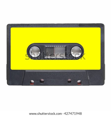 Magnetic tape cassette for audio music recording - isolated over white background - blank yellow label - stock photo