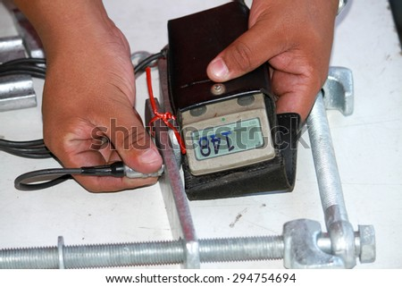 Magnetic thickness gauge for coating of steel galvanized - stock photo