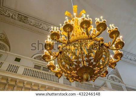 Magnificent  baroque chandelier on the ceiling - stock photo