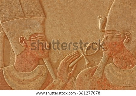Magnificent bas relief of the god amun makes the gift of life (ankh) to the pharaoh Thutmoses IV.  Sculpted in red quartzite, with traces of the original paint remaining - stock photo