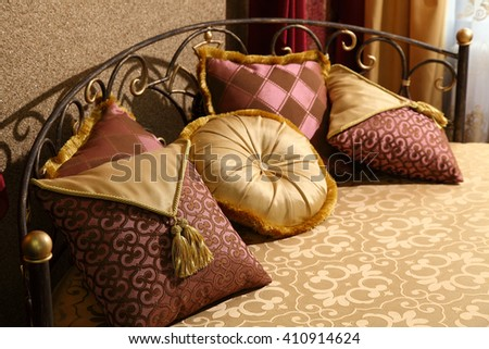 magnificent bed with pillows with east ornament - stock photo