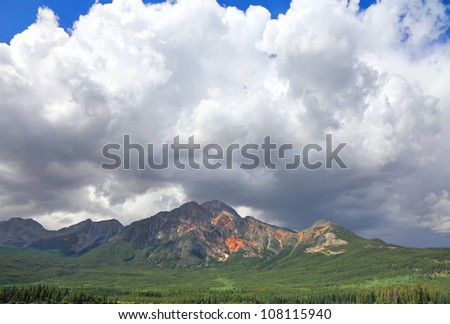 Magnificent cloud over Pyramid mountain in Banff National Park, Rocky Mountains. Banff. Alberta, Canada - stock photo