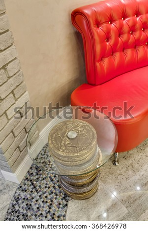 magnificent design little table about red sofa skin - stock photo