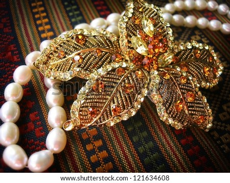Magnificent golden hairpin with vintage pattern. - stock photo