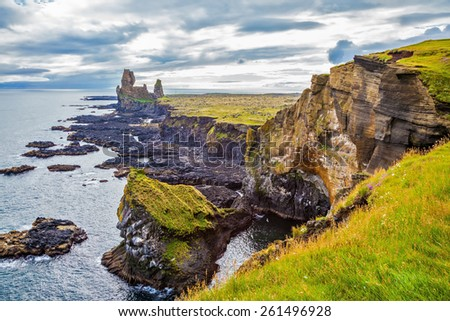 Magnificent Iceland. Northern sea coast. Picturesque ancient Skerries in cloudy summer day - stock photo