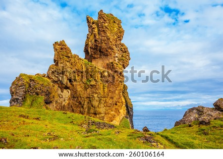 Magnificent Iceland. The picturesque rocks covered with a green and yellow moss. Northern coast of Atlantic - stock photo
