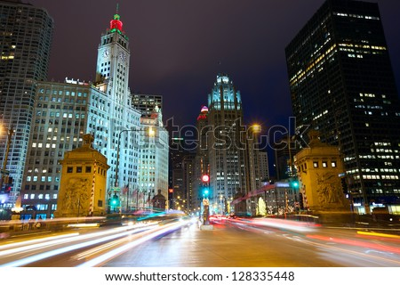 Magnificent Mile with traffic at night, Chicago, IL, USA - stock photo