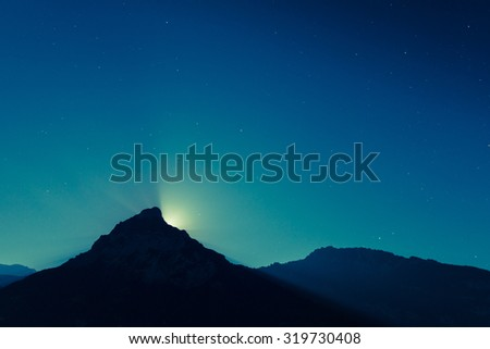 magnificent night sky and stars. Moon over mountain top. - stock photo
