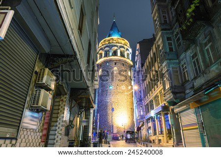 Magnificent night view of Galata Tower, framed by city buildings - Istanbul. - stock photo
