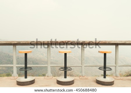 Magnificent outdoor terrace with chairs on sunny terrace with bay view and decoration in contemporary home, Vintage filtered image. - stock photo