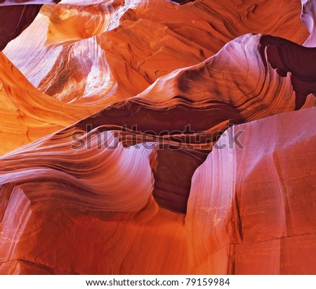 Magnificent play of light and color. Red, pink and purple colors of the famous Antelope Canyon - stock photo