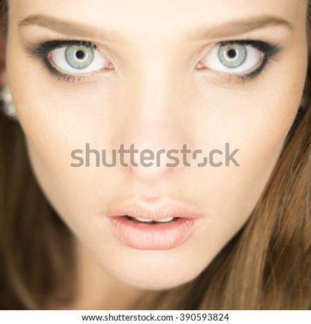 magnificent portrait of a beautiful young woman with perfect skin and blue eyes - stock photo