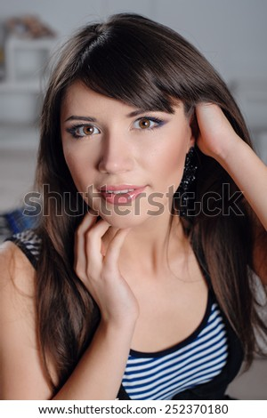 magnificent portrait of a beautiful young woman with perfect skin closeup. - stock photo