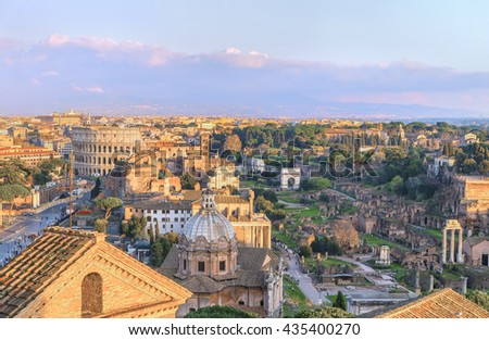 Magnificent Roman Forum, Palatine and Great Colosseum ( Coliseum, Colosseo, Flavian Amphitheatre ) in the evening,at sunset time. Aerial panoramic view on famous touristic landmark. Rome.Italy.Europe. - stock photo