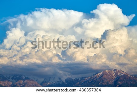 Magnificent storm clouds over mountains - stock photo