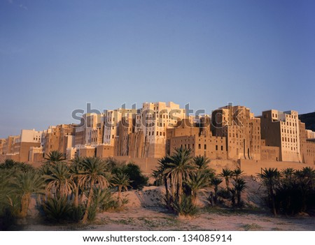 Magnificent sunrise at the skyscrapers of the city of  Shibam in Yemen. This city is situated in the middle of the Hadramaut valley, which is an UNESCO World Heritage site. - stock photo