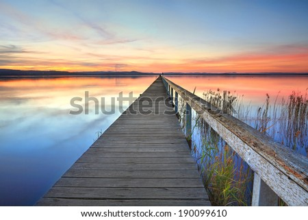 Magnificent sunset and lake reflections at Long Jetty, Central Coast NSW Australia - stock photo