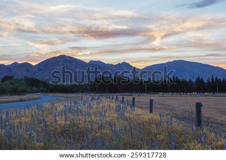 Magnificent  sunset over Canterbury Hills and farmlands, South Island, New Zealand - stock photo