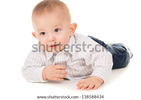 magnificent the child in clothes crawling on the floor isolated on white background