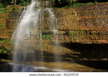 Magnificent waterfall and rainbow restaurant - stock photo