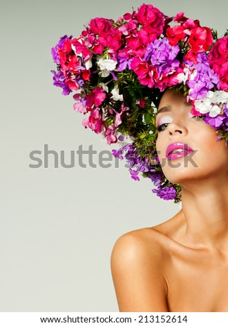 magnificent woman in a hat made of flowers