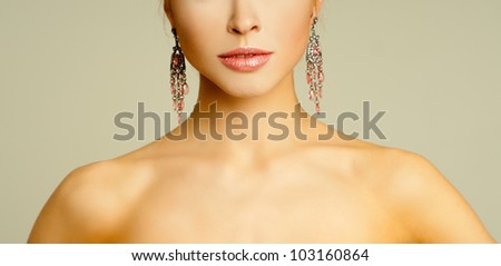 magnificent woman in expensive earrings - stock photo