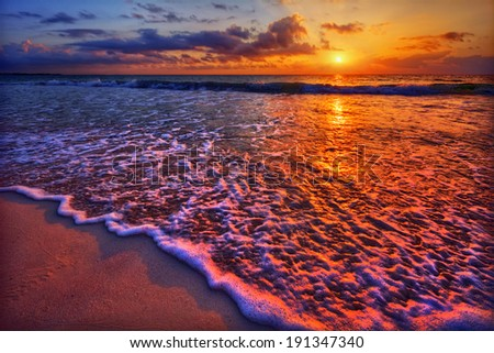 Magnificently colorful beach vacation sunrise 2 - stock photo