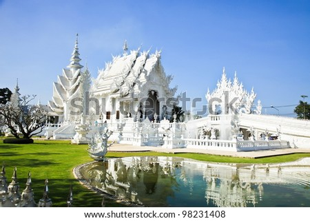 Magnificently grand white church and reflection in the water, Rong Khun temple, Chiang Rai province, northern Thailand - stock photo