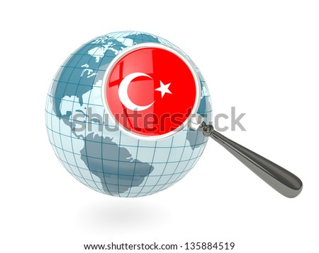 Magnified flag of turkey with blue globe isolated on white