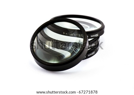 Magnified lenses in white - stock photo