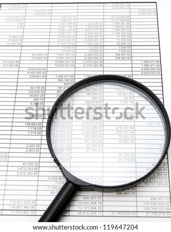 Magnifier and documents. Accounts department. - stock photo