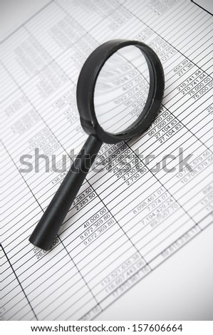 Magnifier and documents. Information search. - stock photo