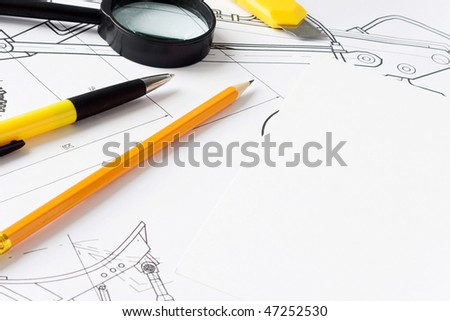 magnifier and office tools at drawing
