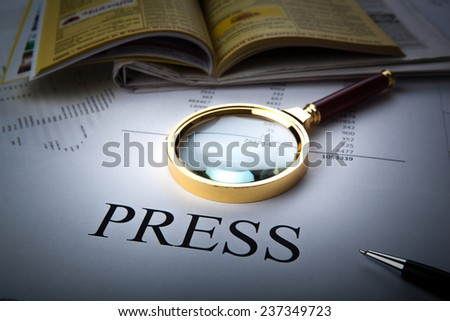 Magnifier and sign the press with adress book close up