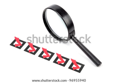 Magnifier glass and checklist - stock photo