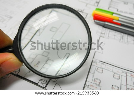 Magnifier glass and paper part of architectural project