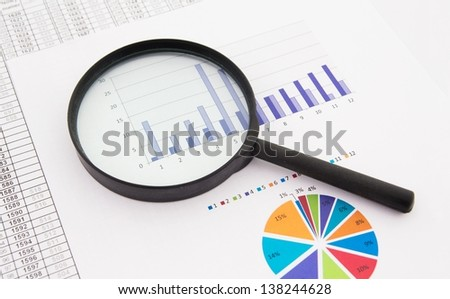 Magnifier on business background. Use for company strategic behavior composition