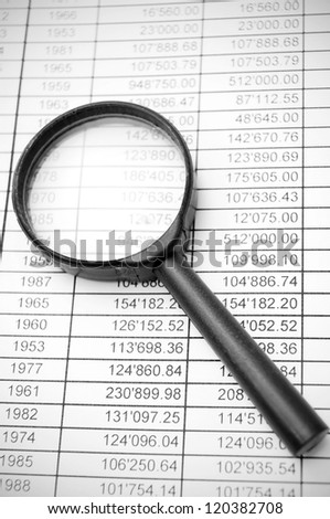 Magnifier on documents. - stock photo