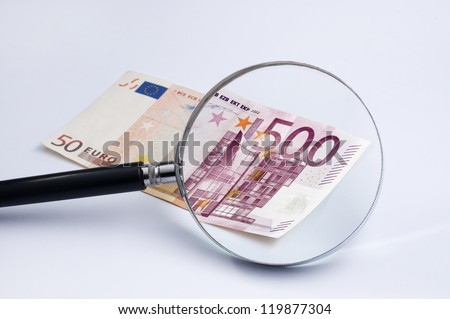 Magnifier over euro banknote