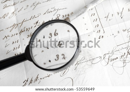 magnifier with ancient letter