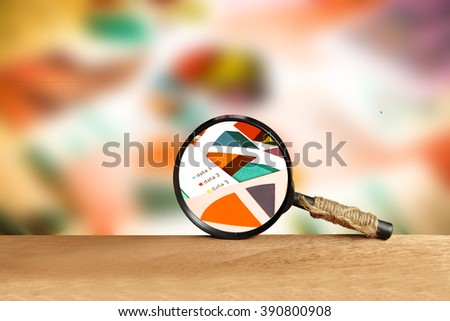 magnifier with blur graph paper background - stock photo