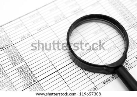 Magnifiers and documents. Accounts department. - stock photo