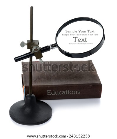Magnify glass and stand with a book  - stock photo