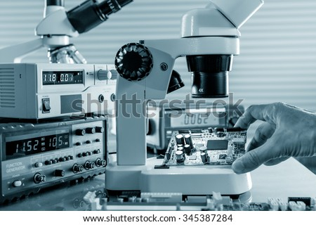 Magnifying devices to work with the chips on a master workplace - stock photo