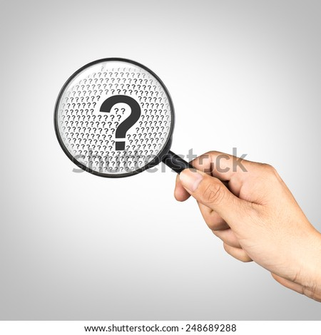 Magnifying glass and a question mark, Question concept - stock photo