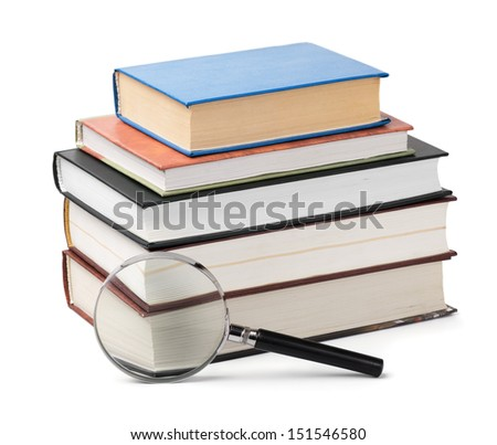 Magnifying glass and books stack isolated on white - stock photo