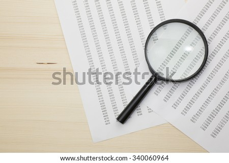 Magnifying glass and data