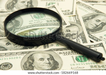 Magnifying glass and money - business background - stock photo