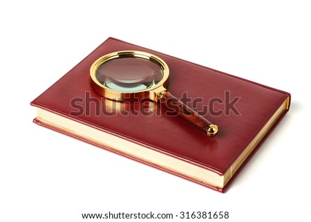 Magnifying glass and notebook isolated on white background - stock photo